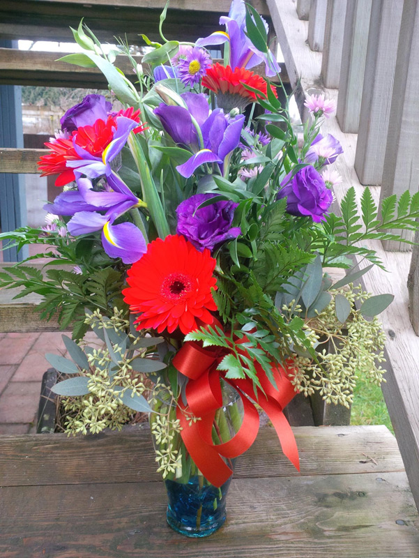 A recently create flower arrangement, ready to go