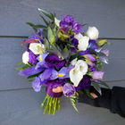 Flower arrangement titled wedding bouquet in purple and white