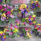 Flower arrangement titled wedding bouquets with much colour