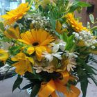 Flower arrangement titled Radiantly Beautiful