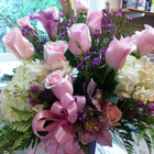 Flower arrangement titled Pretty in Pink