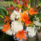 Flower arrangement titled A symphony in orange