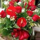 Flower arrangement titled Roses with a Tropical Twist
