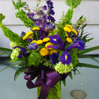 Flower arrangement titled Blooms of Distinction