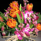 Flower arrangement titled Magenta and Orange Delight
