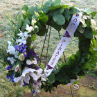 Flower arrangement titled A Wreath of Tribute