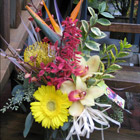 Flower arrangement titled Exotic Embrace