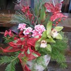 Flower arrangement titled Yuletide Salutations