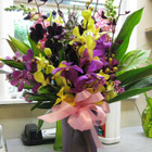 Flower arrangement titled Orchid Romance